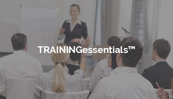 TRAININGessentials text on an image of employees watching a presentation