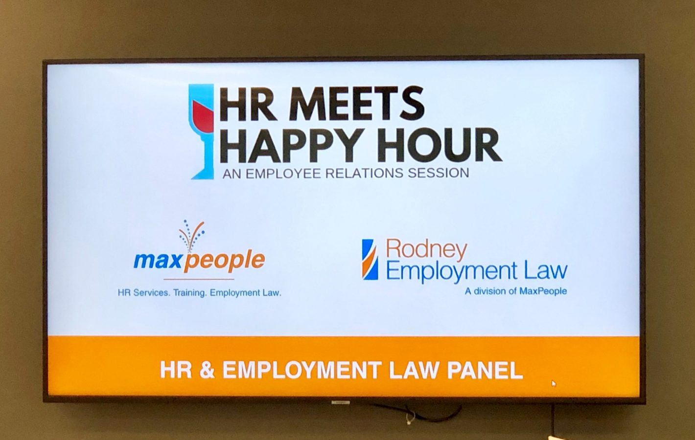 TV showing the HR meets happy hour logo